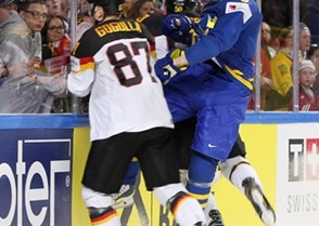 COLOGNE, GERMANY - MAY 6: Sweden's John Klingberg #3 collides with Germany's Philip Gogulla #87 and Patrick Hager #50 during preliminary round action at the 2017 IIHF Ice Hockey World Championship. (Photo by Andre Ringuette/HHOF-IIHF Images)
