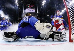 COLOGNE, GERMANY - MAY 7: Russia's Vladimir Tkachyov #70 with a scoring chance against Italy's Frederic Cloutier #29 during preliminary round action at the 2017 IIHF Ice Hockey World Championship. (Photo by Andre Ringuette/HHOF-IIHF Images)