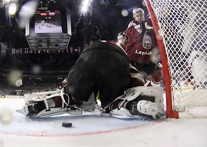 COLOGNE, GERMANY - MAY 7: Latvia's Kristaps Sotnieks #11 looks on as the puck gets through the pads of Elvis Merzlikins #30 during preliminary round action against Slovakia at the 2017 IIHF Ice Hockey World Championship. (Photo by Andre Ringuette/HHOF-IIHF Images)