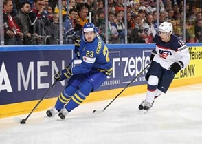 COLOGNE, GERMANY - MAY 8: Sweden's Oliver Ekman-Larsson #23 skates with the puck while USA's Johnny Gaudreau #13 chases him down during  preliminary round action at the 2017 IIHF Ice Hockey World Championship. (Photo by Andre Ringuette/HHOF-IIHF Images)