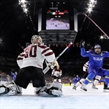 COLOGNE, GERMANY - MAY 9: Italy's Anton Bernard #18 celebrates after a first period goal by Marco Insam #8 (not shown) against Latvia's Elvis Merzlikins #30 during preliminary round action at the 2017 IIHF Ice Hockey World Championship. (Photo by Andre Ringuette/HHOF-IIHF Images)