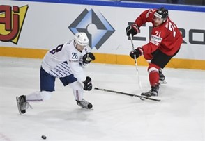 PARIS, FRANCE - MAY 9: Switzerland's Tanner Richard #71 passes the puck past France's Damien Raux #28 during preliminary round action at the 2017 IIHF Ice Hockey World Championship. (Photo by Matt Zambonin/HHOF-IIHF Images)