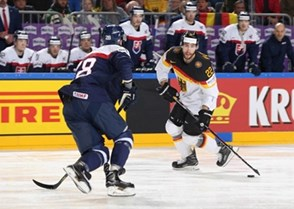 COLOGNE, GERMANY - MAY 10: Germany's Matthias Plachta #22 skates with the puck while Slovakia's Martin Gernat #28 defends during preliminary round action at the 2017 IIHF Ice Hockey World Championship. (Photo by Andre Ringuette/HHOF-IIHF Images)