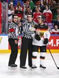 COLOGNE, GERMANY - MAY 12: Linesman Gleb Lazarev holds back Germany's Yasin Ehliz #42 while referee Marcus Linde looks on during preliminary round action against Denmark at the 2017 IIHF Ice Hockey World Championship. (Photo by Andre Ringuette/HHOF-IIHF Images)