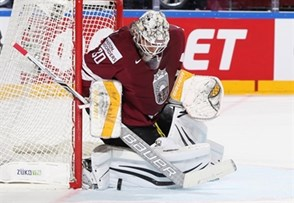 COLOGNE, GERMANY - MAY 13: Latvia's Elvis Merzlikins #30 makes the save during preliminary round action against the U.S. at the 2017 IIHF Ice Hockey World Championship. (Photo by Andre Ringuette/HHOF-IIHF Images)