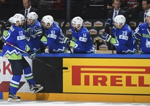 PARIS, FRANCE - MAY 13: Slovenia's David Rodman #12 celebrates with his bench after scoring against Belarus during preliminary round action at the 2017 IIHF Ice Hockey World Championship. (Photo by Matt Zambonin/HHOF-IIHF Images)