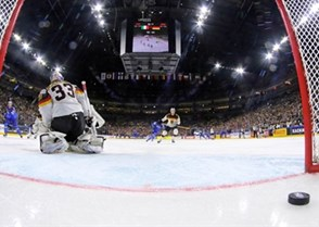 COLOGNE, GERMANY - MAY 13: Italy's Michele Marchetti #68 scores a first period goal against Germany's Danny Aus den Birken #33 during preliminary round action at the 2017 IIHF Ice Hockey World Championship. (Photo by Andre Ringuette/HHOF-IIHF Images)