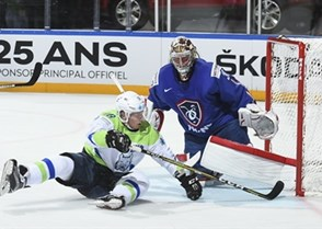 PARIS, FRANCE - MAY 15: Slovenia's Ales Music #16 is tripped by France's Jonathan Janil #3 (not shown) and crashes into Cristobal Huet #39 resulting in a penalty shot during preliminary round action at the 2017 IIHF Ice Hockey World Championship. (Photo by Matt Zambonin/HHOF-IIHF Images)