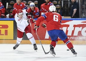 PARIS, FRANCE - MAY 16: Belarus's Pavel Vorobei #55 takes a shot on net while Norway's Jonas Holos #6 defends during preliminary round action at the 2017 IIHF Ice Hockey World Championship. (Photo by Matt Zambonin/HHOF-IIHF Images)