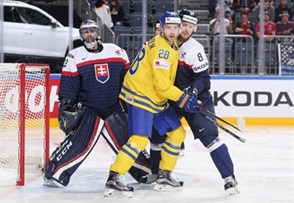 COLOGNE, GERMANY - MAY 16: Sweden's Elias Lindholm #28 battles with Slovakia's Michal Sersen #8 while Julius Hudacek #33 looks on during preliminary round action at the 2017 IIHF Ice Hockey World Championship. (Photo by Andre Ringuette/HHOF-IIHF Images)