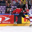 COLOGNE, GERMANY - MAY 20: Canada's Mitch Marner #16 slips by Russia's Vladimir Tkachyov #70 during semifinal round action at the 2017 IIHF Ice Hockey World Championship. (Photo by Andre Ringuette/HHOF-IIHF Images)