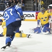 COLOGNE, GERMANY - MAY 20: Sweden's Henrik Lundqvist #35 makes a save against Finland's Mika Pyorala #37 while his teammate Alexander Edler #24 looks on during semifinal round action at the 2017 IIHF Ice Hockey World Championship. (Photo by Matt Zambonin/HHOF-IIHF Images)