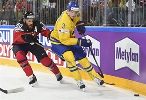 COLOGNE, GERMANY - MAY 21: Canada's Ryan O'Reilly #90 stickchecks the puck away from Sweden's John Klingberg #3 during gold medal game action at the 2017 IIHF Ice Hockey World Championship. (Photo by Matt Zambonin/HHOF-IIHF Images)