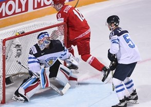 PARIS, FRANCE - MAY 5: Finland's Joonas Korpisalo #70 keeps track of the puck behind his net while his teammates Joonas Kemppainen #23, Juhamatti Aaltonen #50 and Belarus's Mikhail Stefanovich #10 look on during preliminary round action at the 2017 IIHF Ice Hockey World Championship. (Photo by Matt Zambonin/HHOF-IIHF Images)