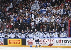PARIS, FRANCE - MAY 14: Finland's Juuso Hietanen #38 celebrates with his bench after scoring against Switzerland during preliminary round action at the 2017 IIHF Ice Hockey World Championship. (Photo by Matt Zambonin/HHOF-IIHF Images)