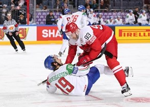 COLOGNE, GERMANY - MAY 15: Denmark\s Peter Regin #93 takes down Italy's Raphael Andergassen #19 during preliminary round action at the 2017 IIHF Ice Hockey World Championship. (Photo by Andre Ringuette/HHOF-IIHF Images)