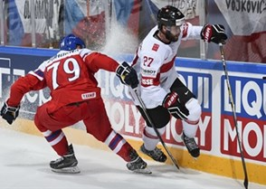 PARIS, FRANCE - MAY 16: Switzerland's Dominik Schlumpf #27 avoids a bodycheck from Czech Republic's Tomas Zohorna #79 during preliminary round action at the 2017 IIHF Ice Hockey World Championship. (Photo by Matt Zambonin/HHOF-IIHF Images)
