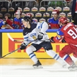COLOGNE, GERMANY - MAY 21: Finland's Jesse Puljujarvi #39 skates with the puck while being stick checked by Russia's Andrei Mironov #94 during bronze medal game action at the 2017 IIHF Ice Hockey World Championship. (Photo by Matt Zambonin/HHOF-IIHF Images)